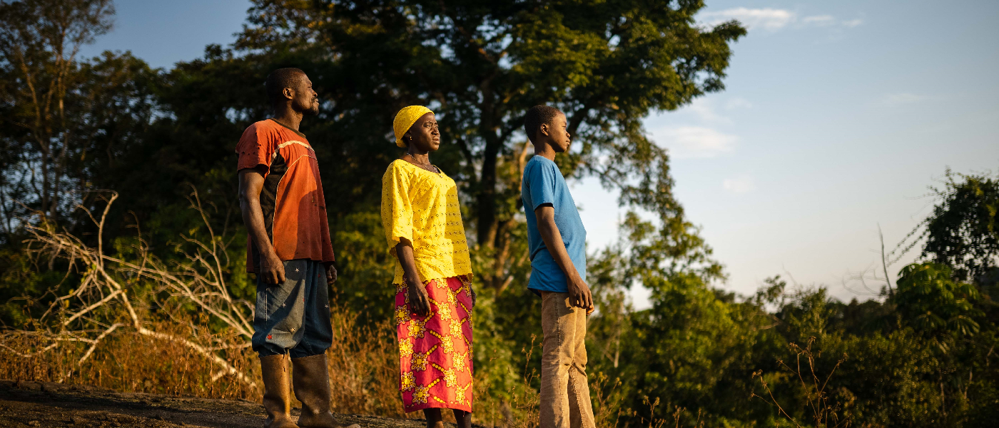 Father mother and son looking out over the Gola Rainforest in Sierra Leone